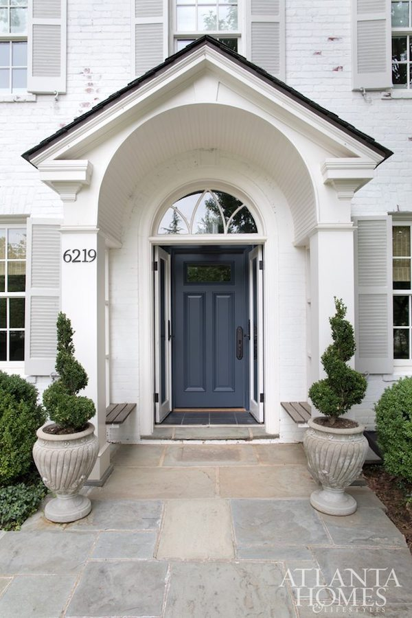 family friendly style white brick home front entry