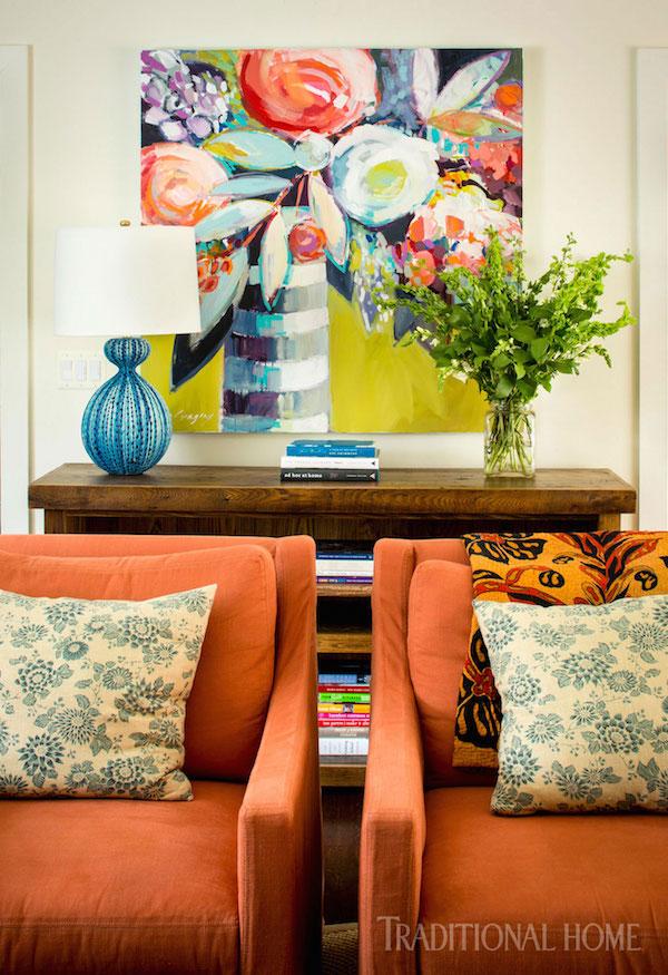 bold orange chairs with bright art
