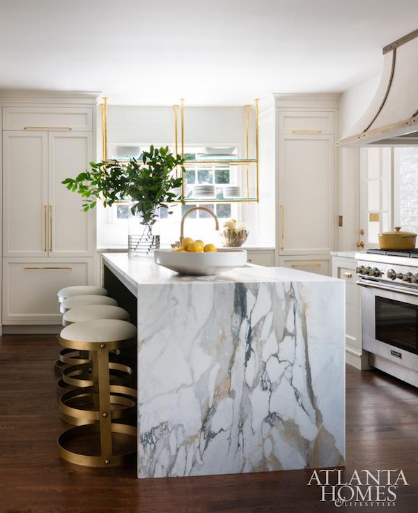 marble slab waterfall island kitchen
